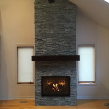 Rheal-Stone-Custom-Fireplace-By-Romantic-Fireplaces